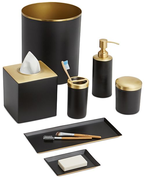 Matte black metal tailored with sleek gold-tone accents creates the sophisticated air of the Paradigm Tuxedo Black Bath Accessories Collection.