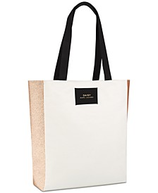 Receive this Complimentary Tote Bag with any large spray purchase from the MARC JACOBS Daisy fragrance collection