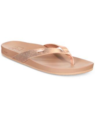 gold flip flops