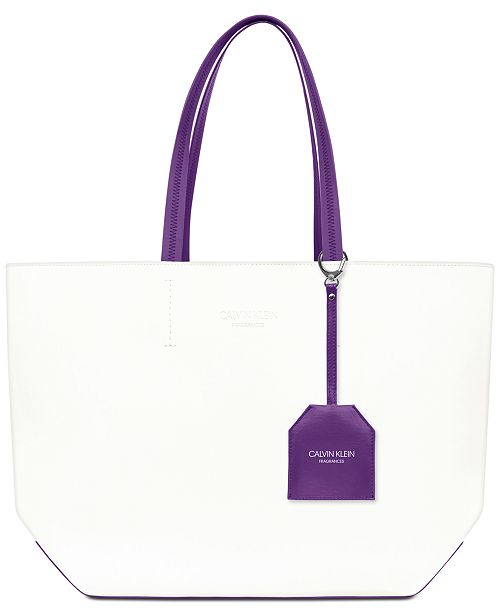 Calvin Klein Receive a Complimentary Tote Bag with any large spray purchase from the Calvin Klein Euphoria Women's fragrance collection
