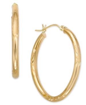 10k Gold Oval Hoop Earrings...