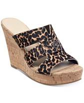 66415502c133 GUESS Women s Eadra Wedge Slide Sandals