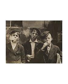 """Lewis Wickes Hine 'Newsies at Skeeter's Branch 1910' Canvas Art - 14"""" x 19"""""""