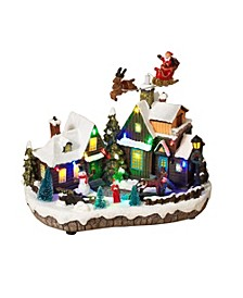 Lighted Holiday Village Scene with Seasonal Accents and Moving Figurines