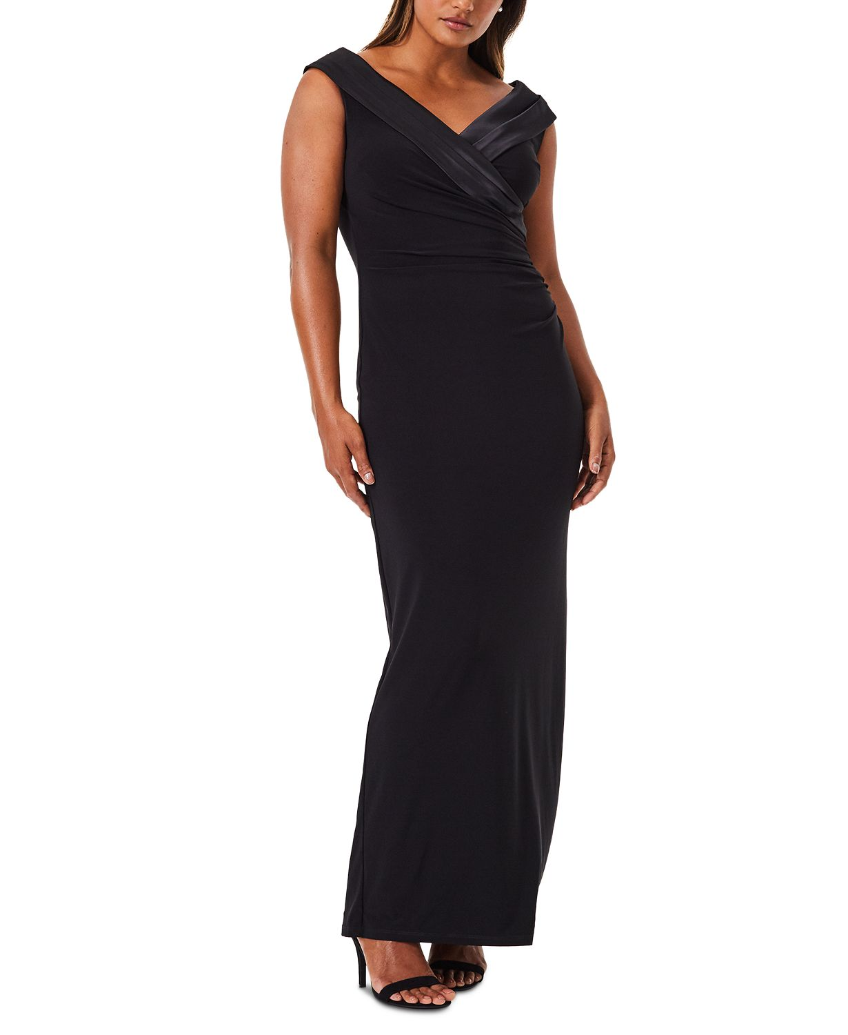 Woman in a black Sleeveless Portrait-Collar Draped Christmas party Gown