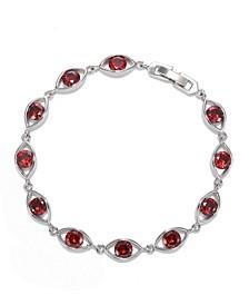 Silver-Tone Garnet Accent Oval Tennis Bracelet
