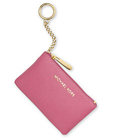 Receive a free coin purse with a Michael Kors watch purchase of $225 or more. Online only. While supplies last.