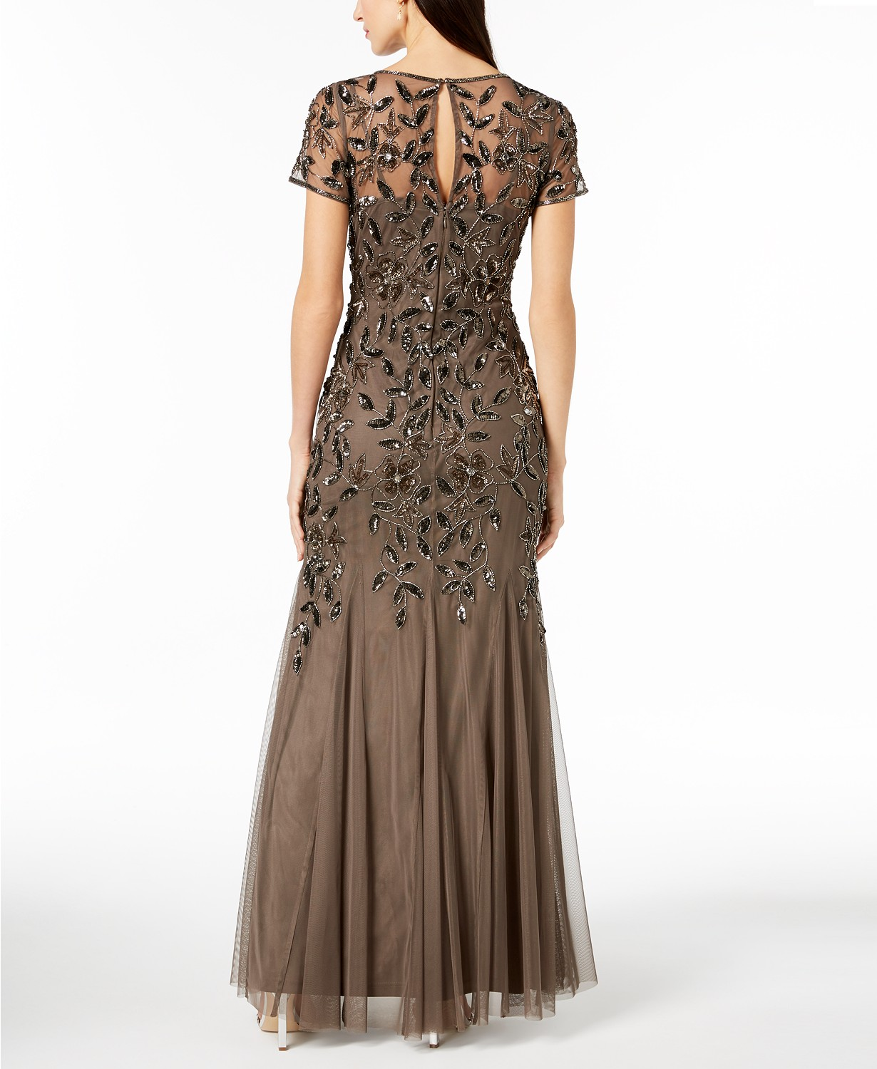 cdf28cf3a7d5 Emulate Hollywood glamour in this enchantingly embellished floor-length gown  by Adrianna Papell.