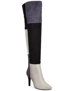 The slim elongated silhouettes of the Rialto Carpio colorblocked over-the-knee boots feature a trio of faux-suede shades in varied shapes to bring multifaceted flair to every step.