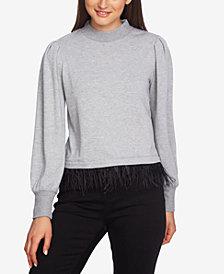 1.STATE Cozy Feather-Hem Mock-Neck Sweater