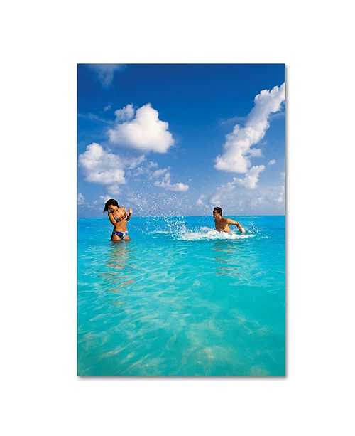 """Trademark Global Robert Harding Picture Library 'Playing In Water' Canvas Art - 19"""" x 12"""" x 2"""""""