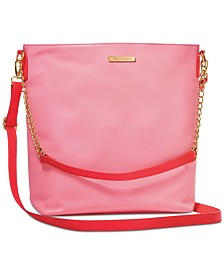 Receive a Complimentary Handbag with any large spray purchase from the Juicy Couture Women's fragrance collection