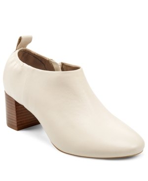 Look sharp, stay comfortable. This versatile bootie combines a clean, classic silhouette with a walk-able leather stacked heel and elasticized back for extra comfort. Dress it up for the office or pair with jeans for a casual weekend look. Heel Rest Technology. Genuine leather upper, balance synthetic materials.