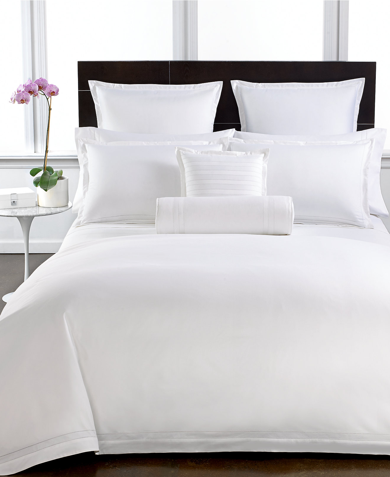 White cotton bed sheets -