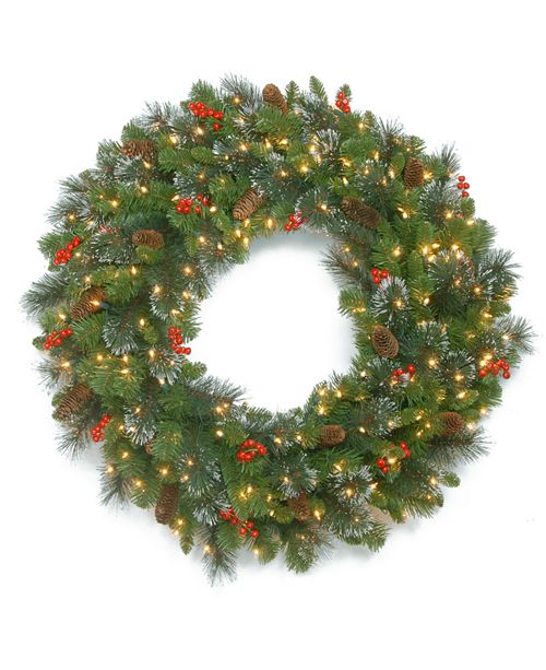 "National Tree Company 48"" Crestwood Spruce Wreath with Silver Bristle, Cones, Red Berries and Glitter with 250 Clear Lights"