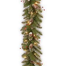"National Tree Company 9' x 10"" Glittery Mountain Spruce Garland with White Edged Cones, Red Berries and 50 Clear Lights"