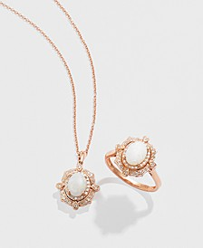 Diamond (1/6 c.t. t.w.) and Opal (5/8 c.t. t.w.) Pendant in 14K Rose Gold