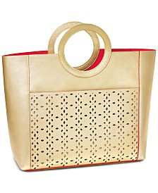 Receive a Complimentary Tote Bag with any purchase from the Elizabeth Taylor White Diamonds fragrance collection