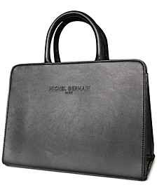 Receive a Free Handbag with any $100 purchase from the fragrance collection