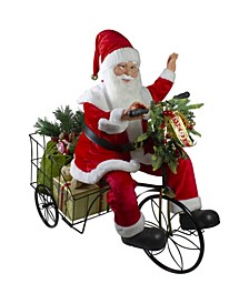 Pre-Lit LED Animated and Musical Santa Claus Riding a Tricycle Christmas Figurine