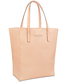 Receive a Complimentary Tote with any large spray purchase from the Calvin Klein Women's fragrance collection