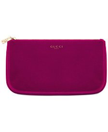 Receive a Complimentary Pouch with any large spray purchase from the Gucci Guilty Women's fragrance collection