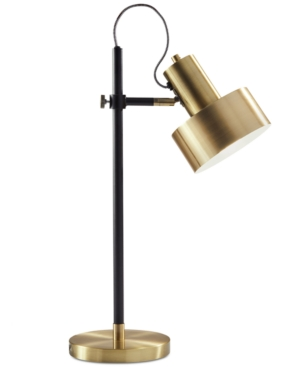 Enhance your space with the mid-century modern Clayton table lamp from Adesso. The adjustable canister shade in a brilliant antique-brass tone lets you direct light where it\\\'s needed and complements the matching foot and slender black pole base.
