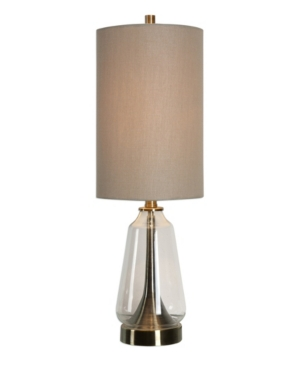 Clear glass base accented with spun metal details finished in a plated antique brass. The round hardback drum shade is a warm khaki linen fabric.