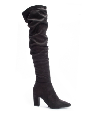 Super slouchy means super-chic in this dramatically tall boot lofted even higher on a smart demi-block heel