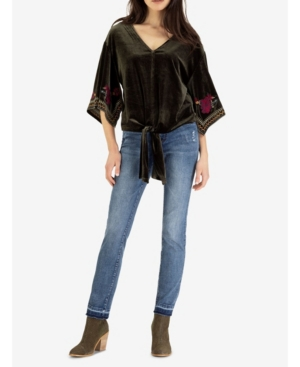 Step into the season in style with this one-of-a-kind kimono top. Made of emerald-tone velvet with a romantic tie in the front, its unique cascading sleeves are decorated with framed floral embroidery, alongside a front seam detail and elegant V-neck.