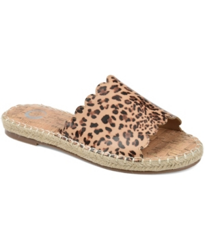 The scalloped edges on the Marjan espadrille slide sandal give some extra oomph to this simple, elegant sandal. Soft faux leather and a synthetic cork insole provide all-day comfort. Whipstitch details add the perfect touch. Available in leopard print.
