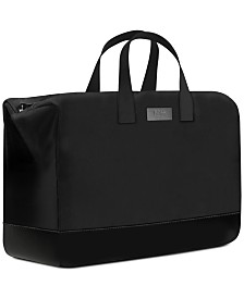Receive a Complimentary Weekender Duffel Bag with any large spray purchase from the Men's Hugo Boss The Scent fragrance collection