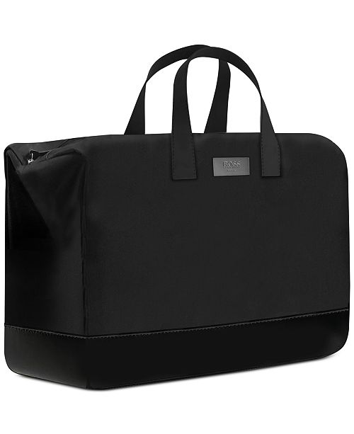 587de875775 Hugo Boss. Receive a Complimentary Weekender Duffel Bag with any large  spray purchase from the Men's Hugo Boss The Scent fragrance collection